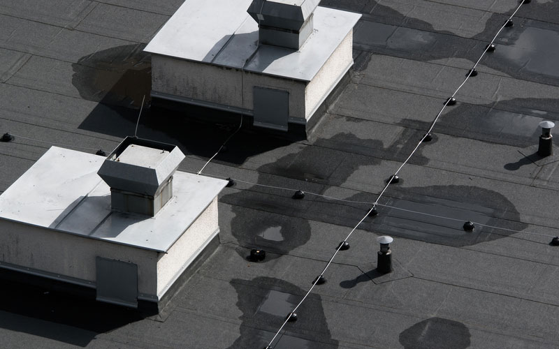Built up roofs and coatings